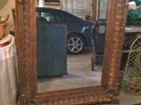 Large, Heavy, antiqued gold mirror. Asking $400.