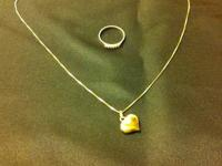 For sale a gold pendant with heart and a gold ring with