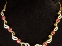 Unique and chic, this gold tone necklace set will be a