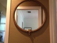 Lovely round mirror with wood detail.  30.5 W x 36.5