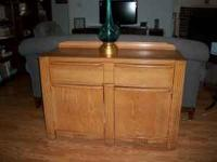 "Golden Oak Buffet solid wood. 48""x17""x32 1/2"". Call"