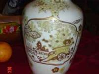 Fine Japanese porcelin vase and matching candy dish.