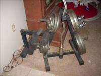 This is a golds gym weight bench with weight stand and