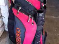 JayHawks golf bag and miscellaneous mens golf clubs.