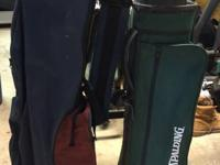 A pair of golf bags. They are used but both get the job