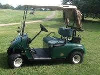 Terrific condition battery golf cart. Garage kept,