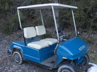 For Sale is a nice looking blue golf cart. It is in