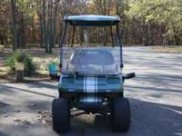 I have a completely customized 2002 Club Car Golf Cart.