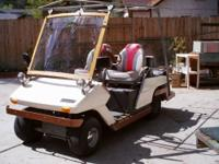 Golf cart pre 1975 Cushman Town and Fairway 4 seater,