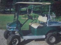 This is  a 2005 electric EZ-Go golf cart. It has