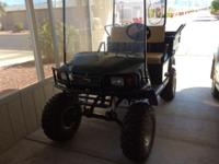 Ezgo workhorse ST350. Low hours, windshield, seats A-1,