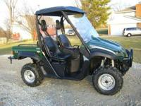 Gas powered Yamaha golf cart. Lifted, off road tires.