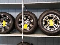 "2 sets of 4 -12"" tires and wheels 1 set of 4 - 14"""