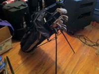Set of 13 golf clubs with golf bag. They appear to be