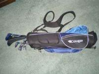 Beginner set of Cougar golf clubs with blue stand bag.