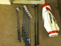Irons 3 4 5 6 7 8 9, two wedges,and two woods i believe