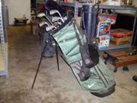 Golf clubs in green nike bag. Call or text for more