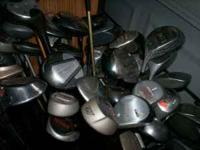 Hundreds of golf clubs for sale. Some new. From putters