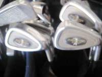 A GREAT SET OF GOLF DYNAMICS CAVITY BACK GOLF CLUBS.