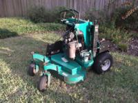 Multiple mowers, a pressure washer, and Stihl Blower