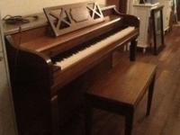 Good practice piano with bench, both in attractive