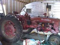 1949 Farmall C. Has been switched over to 12 volt