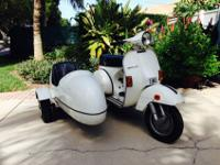The scooter is in good condition with white pait it has