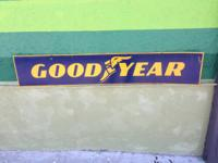 We have a vintage GOODYEAR double sided metal sign! Its