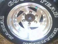 set of 4 goodyear wrangler tires on aluminum rims. $400