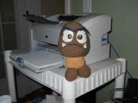 I am selling a crocheted Goomba doll. It is in good