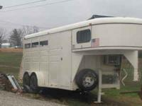 I have a white goose neck horse trailer in really good