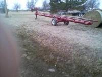 Inline self unloading gooseneck hay trailer. It is 32ft