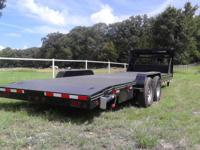 New gooseneck lowboy steel deck automobile hauler,