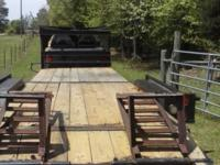 A good condition home made gooseneck flatbed 22 feet