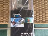brand new black GoPro Hero 4, 12MP, wifi and bluetooth