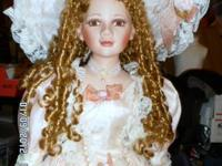 Up for sale is this gorgeous 46 inch porcelain doll