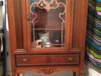We are offering a stunning antique china cabinet with