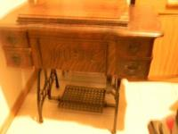 This is a really very antique treadle sewing device. It