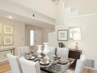 Updated townhome in gated community. Beautifully