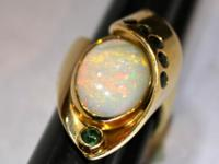 Beautiful 6 carat opal cabochon set in a heavy (weighs