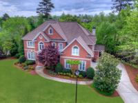 This exquisite brick executive home located in the