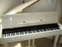 This beautiful digital baby grand piano is in like~new