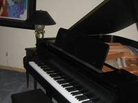 "For sale is a Kawai GE-1 5'1"" baby grand piano with"