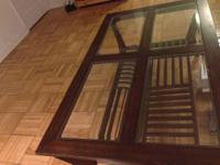 Coffee table with four removable glass panels and a