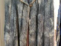 This is a gorgeous fur coat in excellent condition!