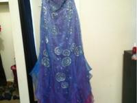 $500 hand beaded pageant gown. Beautiful colors,