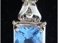 Intense clean cut princess cut blue topaz !! Set in