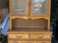 We have a stunningly beautiful solid oak china hutch