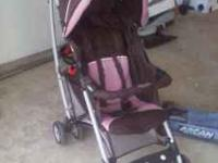 Selling my daughters pinkand brwon stroller EXCELLENT