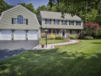 Gracious six bedroom center entrance Colonial is tucked